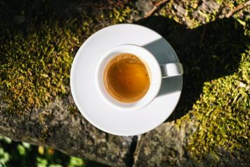 Cup of Espresso Macchiato. Symbolic image. Bright naturestone background. Close up with sunlight- Stock Photo or Stock Video of rcfotostock   RC-Photo-Stock