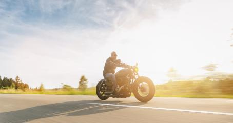 custom motorbike riding on the road. having fun driving the empty road on a motorcycle tour journey. copyspace for your individual text.- Stock Photo or Stock Video of rcfotostock   RC-Photo-Stock