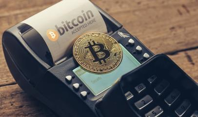 Customer pays by bitcoin to pay a bill at the cafe (bitcoin accepted here) : Stock Photo or Stock Video Download rcfotostock photos, images and assets rcfotostock | RC-Photo-Stock.: