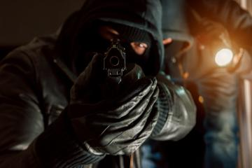 dangerous burglar duo with a Gun in his hand- Stock Photo or Stock Video of rcfotostock | RC-Photo-Stock
