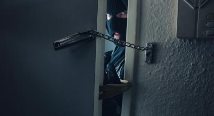 dangerous masked burglar with crowbar breaking into a victim's home door : Stock Photo or Stock Video Download rcfotostock photos, images and assets rcfotostock | RC-Photo-Stock.: