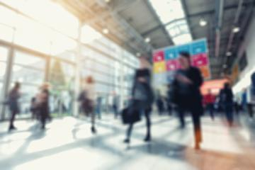 defocused background of business people walking in a floor, business trade show concept- Stock Photo or Stock Video of rcfotostock | RC-Photo-Stock