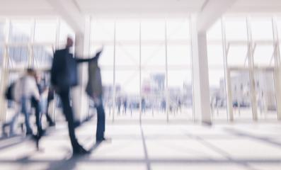 defocused business commuters walking in a floor at a airport, business travel concept- Stock Photo or Stock Video of rcfotostock | RC-Photo-Stock