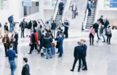 defocused business people rushing in trade show hall- Stock Photo or Stock Video of rcfotostock | RC-Photo-Stock