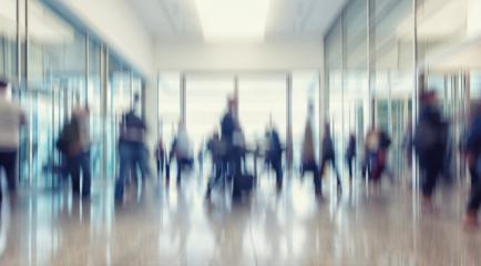 defocused business people walking in a entrance, business concept image- Stock Photo or Stock Video of rcfotostock | RC-Photo-Stock