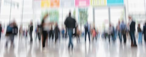 defocused business people walking in trade show hall- Stock Photo or Stock Video of rcfotostock   RC-Photo-Stock