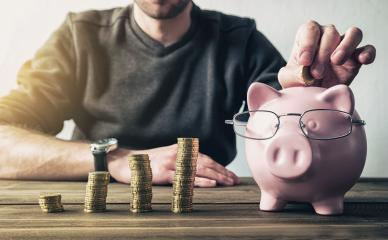 Depositing money in a piggy bank- Stock Photo or Stock Video of rcfotostock | RC-Photo-Stock