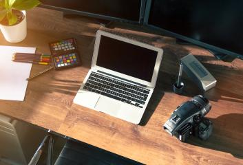 Desktop shot of a modern Digital Photo Camera with Laptop- Stock Photo or Stock Video of rcfotostock | RC-Photo-Stock