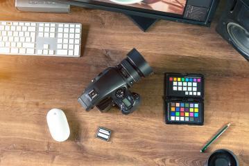 Desktop shot of a modern Digital Photo Camera with Laptop- Stock Photo or Stock Video of rcfotostock | RC-Photo-Stock