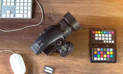 Desktop shot of a modern Digital Photo Camera with Laptop : Stock Photo or Stock Video Download rcfotostock photos, images and assets rcfotostock   RC-Photo-Stock.: