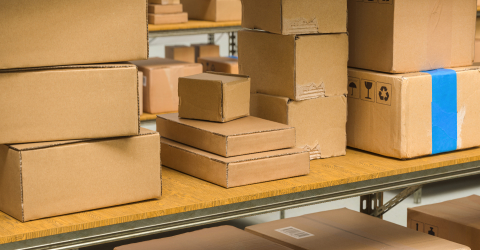 different cardboard boxes on shelves in a warehouse, Packed courier delivery concept image- Stock Photo or Stock Video of rcfotostock | RC-Photo-Stock