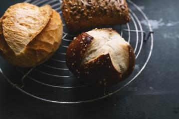 Different kinds of bread rolls of a bakery grid on a black board  : Stock Photo or Stock Video Download rcfotostock photos, images and assets rcfotostock | RC-Photo-Stock.: