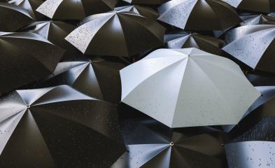 Different, unique and standing out of the crowd gray umbrella with rain drops- Stock Photo or Stock Video of rcfotostock | RC-Photo-Stock