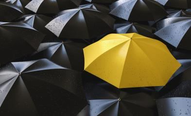 Different, unique and standing out of the crowd yellow umbrella with rain drops- Stock Photo or Stock Video of rcfotostock | RC-Photo-Stock
