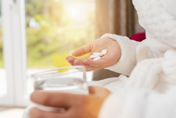 different white pills in young female hand with water glass- Stock Photo or Stock Video of rcfotostock | RC-Photo-Stock