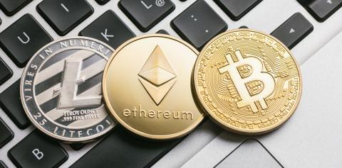 Digital cryptocurrencys Bitcoin, Ethereum, Litecoin on a notebook- Stock Photo or Stock Video of rcfotostock | RC-Photo-Stock