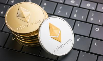 Digital currency physical Ethereum coins on black computer keyboard : Stock Photo or Stock Video Download rcfotostock photos, images and assets rcfotostock | RC-Photo-Stock.: