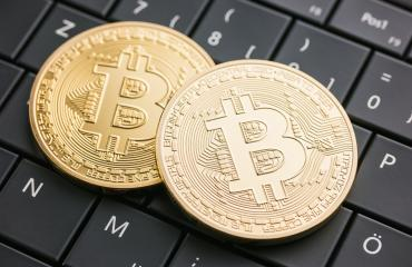 Digital currency physical golden bitcoin coins on black computer keyboard- Stock Photo or Stock Video of rcfotostock   RC-Photo-Stock