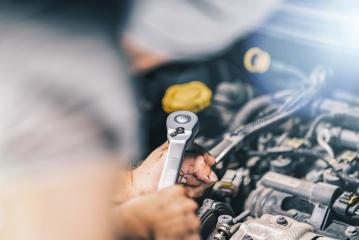 DIY Auto mechanic working in garage with wrench- Stock Photo or Stock Video of rcfotostock   RC-Photo-Stock