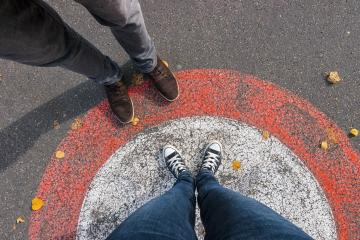 do not cross the line between us young woman and man at the streets, personal pespective from above.- Stock Photo or Stock Video of rcfotostock | RC-Photo-Stock