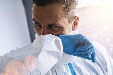 Doctor in clinic with protective clothing s coughs in his elbow at coronavirus covid-19 epidemic. Concept of stop spread of the virus.- Stock Photo or Stock Video of rcfotostock | RC-Photo-Stock