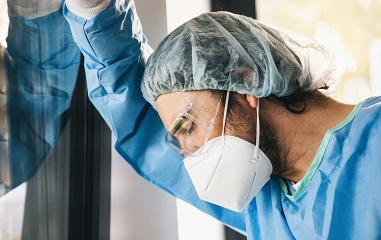 Doctor in protective clothing under stress with burnout during Covid-19 coronavirus epidemic- Stock Photo or Stock Video of rcfotostock | RC-Photo-Stock