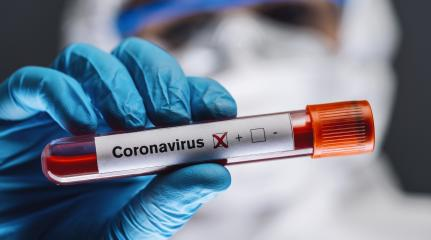 doctor or nurse in protective suit and face shield holding a positive blood test result for coronavirus or covid-19- Stock Photo or Stock Video of rcfotostock | RC-Photo-Stock