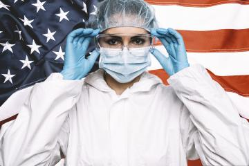 Doctor or Nurse Wearing Medical Personal Protective Equipment (PPE) Against The American Flag Banner.- Stock Photo or Stock Video of rcfotostock | RC-Photo-Stock