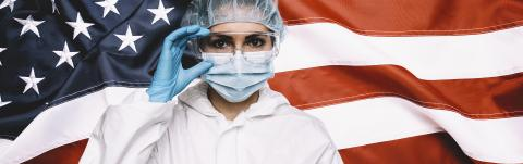 Doctor or Nurse Wearing Medical Personal Protective Equipment (PPE) Against The American Flag Banner, banner size- Stock Photo or Stock Video of rcfotostock | RC-Photo-Stock