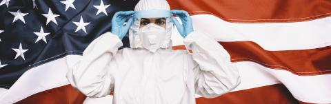 Doctor or Nurse Wearing Medical Personal Protective Equipment (PPE) with protective shield, Against The American Flag Banner. prevent corona COVID-19 and SARS infection concept image, banner size- Stock Photo or Stock Video of rcfotostock | RC-Photo-Stock