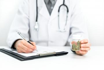 Doctor prescribes CBD for pain relief and healing. Doc holds medical marijuana in hand, offers medical cannabis, legal light medication, alternative remedies or medicines, medicine concept to patien : Stock Photo or Stock Video Download rcfotostock photos, images and assets rcfotostock | RC-Photo-Stock.: