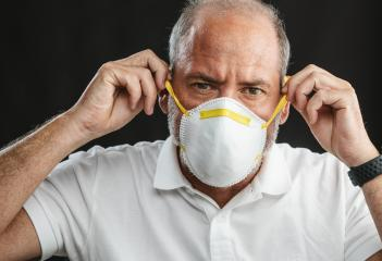 Doctor wearing an anti virus protection mask to prevent others from corona COVID-19 and SARS cov 2 infection- Stock Photo or Stock Video of rcfotostock | RC-Photo-Stock