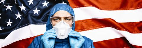 Doctor wearing protection Suit for Fighting Covid-19 (Corona virus) SARS infection Protective Equipment (PPE), Against The American Flag Banner. banner size.- Stock Photo or Stock Video of rcfotostock | RC-Photo-Stock