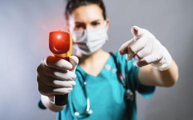 doctor wearing protective surgical mask ready to use infrared forehead thermometer (thermometer gun) to check body temperature for corona virus COVID-19 and SARS cov 2 infection symptoms : Stock Photo or Stock Video Download rcfotostock photos, images and assets rcfotostock | RC-Photo-Stock.: