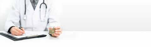 Doctor writing a prescription. He is holding a bottle of medical CBD cannabis in his hand. Legal healing cannabis for alternative medicine. : Stock Photo or Stock Video Download rcfotostock photos, images and assets rcfotostock | RC-Photo-Stock.: