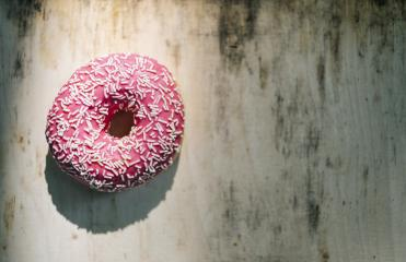 donut with pink glazed and sprinkles on a wooden table, including Copy space : Stock Photo or Stock Video Download rcfotostock photos, images and assets rcfotostock | RC-Photo-Stock.: