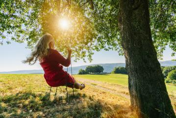 dream concept, beautiful young woman on the swing, inspiring landscape- Stock Photo or Stock Video of rcfotostock | RC-Photo-Stock