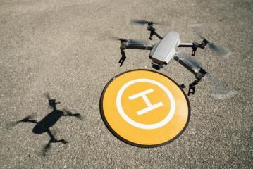 Drone flying at the heliport- Stock Photo or Stock Video of rcfotostock | RC-Photo-Stock