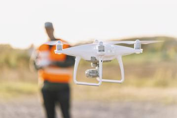 Drone inspection. Operator inspecting construction building site flying with drone- Stock Photo or Stock Video of rcfotostock | RC-Photo-Stock