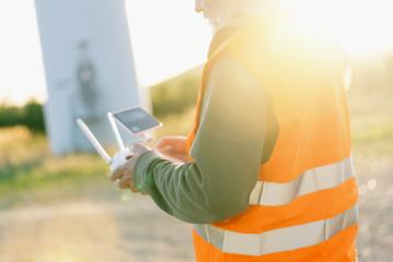 Drone inspection. Operator inspecting construction site flying with drone- Stock Photo or Stock Video of rcfotostock   RC-Photo-Stock