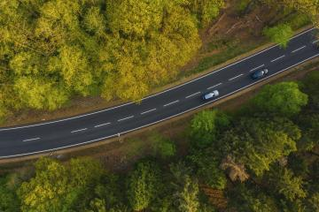 Drone view of cars driving on suburban road on background summer forest : Stock Photo or Stock Video Download rcfotostock photos, images and assets rcfotostock | RC-Photo-Stock.: