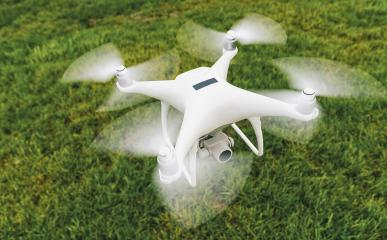 Drone with camera and black plaque over a green meadow- Stock Photo or Stock Video of rcfotostock | RC-Photo-Stock