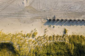 Dunes with green grass at beach in the Netherlands at the Northern Sea, drone shot- Stock Photo or Stock Video of rcfotostock | RC-Photo-Stock