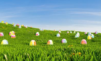 Easter background. Easter eggs laying in green grass under blue sky, including Copy Space- Stock Photo or Stock Video of rcfotostock | RC-Photo-Stock