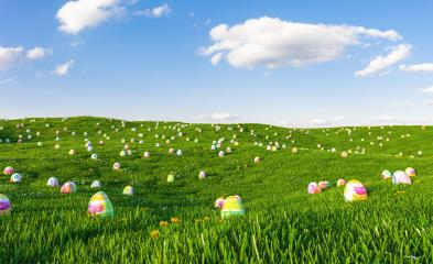 Easter background. Easter eggs laying in green grass under blue cloudy sky.- Stock Photo or Stock Video of rcfotostock | RC-Photo-Stock