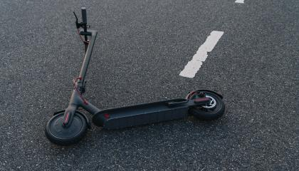 electric scooter or e-scooter lies on the road after a accident, Electric urban transportation concept image - Stock Photo or Stock Video of rcfotostock | RC-Photo-Stock