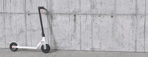 Electric scooter or e-scooter on wall for mobility in the city- Stock Photo or Stock Video of rcfotostock | RC-Photo-Stock