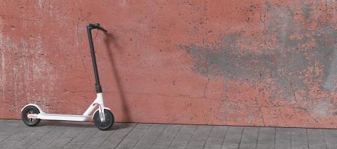 Electric scooter parked on a wall for mobility in the city- Stock Photo or Stock Video of rcfotostock | RC-Photo-Stock