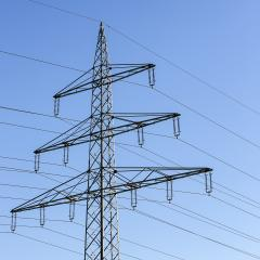 Electricity pylon close-up power pole high voltage against blue sky- Stock Photo or Stock Video of rcfotostock | RC-Photo-Stock