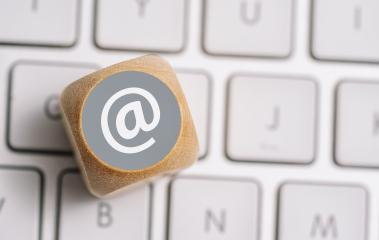 Email at icon on a wood cube on a keyboard. Contact and Communication Methods concept image- Stock Photo or Stock Video of rcfotostock   RC-Photo-Stock